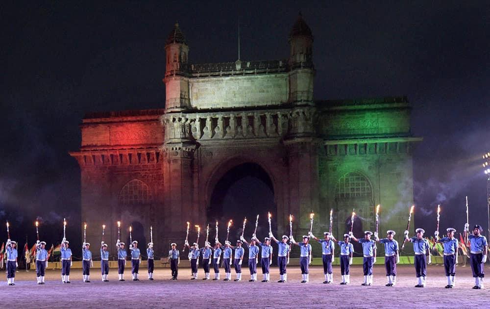 Navy soldiers rehearse for the Beating Retreat and Tattoo Ceremonies during the Navy week at the historic Gateway of India in Mumbai.