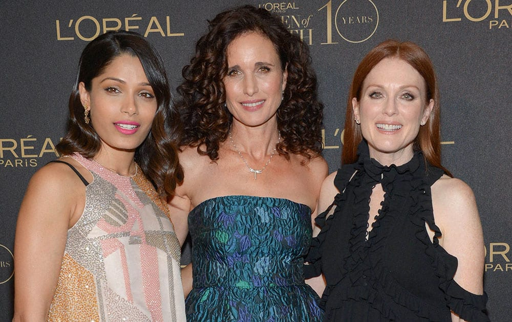 LOreal brand ambassadors, from left, Freida Pinto, Andie MacDowell and Julianne Moore pose together at the tenth annual LOreal Paris Women of Worth awards gala at The Pierre Hotel in New York.