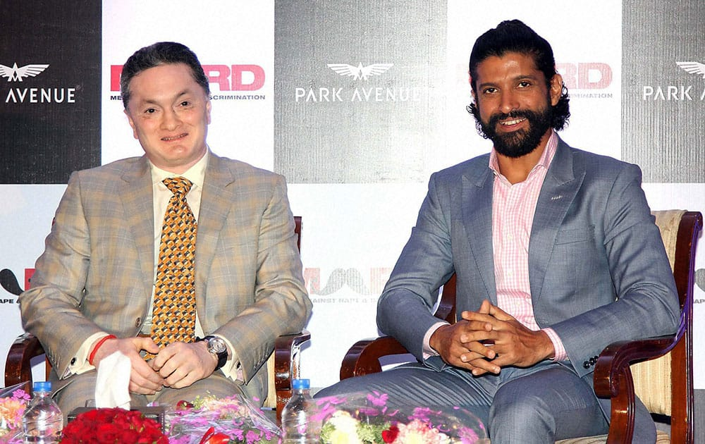 Bollywood actor and filmmaker Farhan Akhtar and Gautam Singhania, CMD, Raymond Group during the launch of Park avenue deodorants in association with Men against Rape and Discrimination (MARD), in Mumbai.