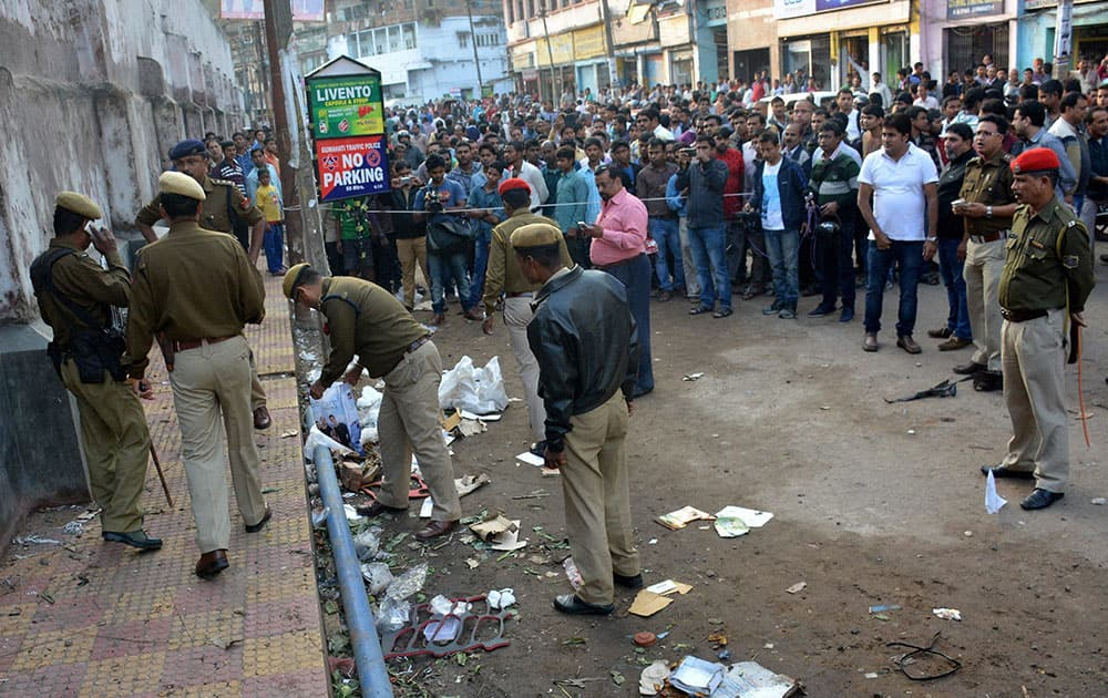 Police personnel investigating at the spot after a bomb blast took place at Jail Road, Fancy Bazar in Guwahati.