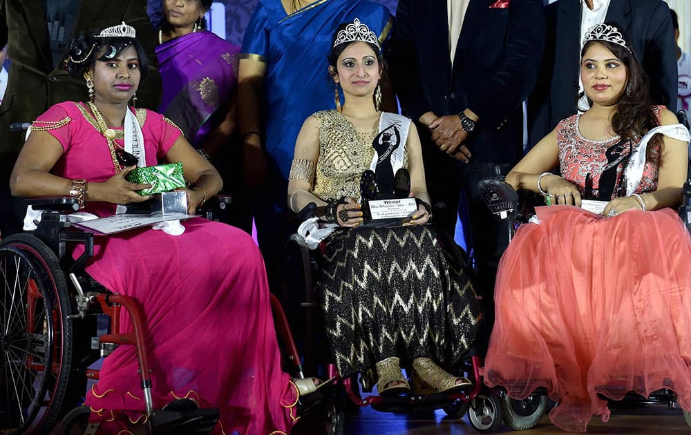 Miss Wheelchair India 2015 Winner Priya Bhargava(C) from Delhi flanked by 1st runner up Sunakshi Bawa(R) from Punjab and 2nd runner up Chaya Kashti(L) from Karnataka during the Miss Wheel Chair 2015 Beauty pageant for women with disability in Bengaluru.