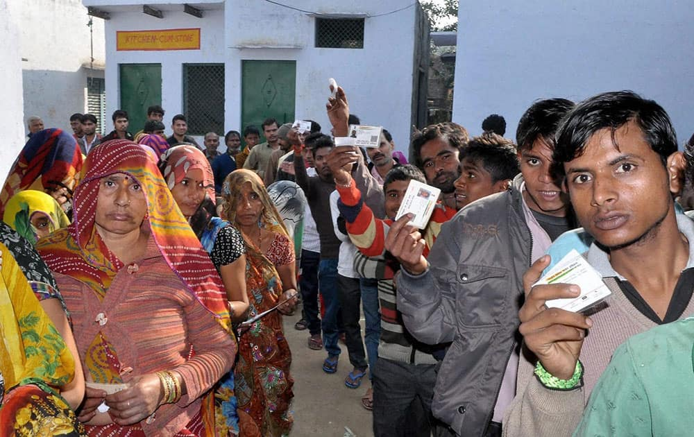 People wait to cast votes for Gram Panchayat elections in Mathura.