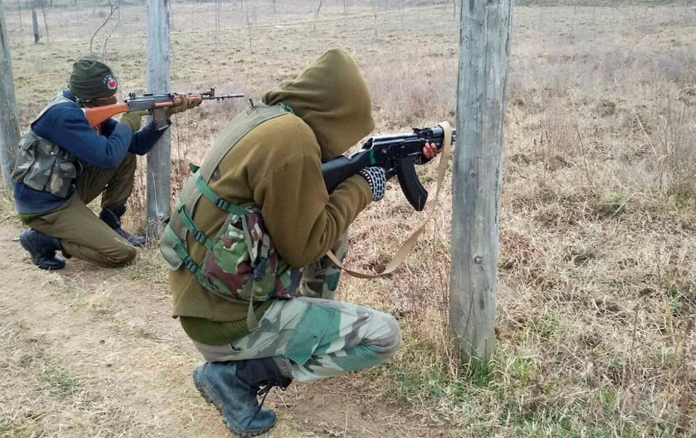 Special Operation Group (SOG) personnel take positions during a Armys massive search operation against the militants hiding in Baban Rajwar Forest area of Handwara.