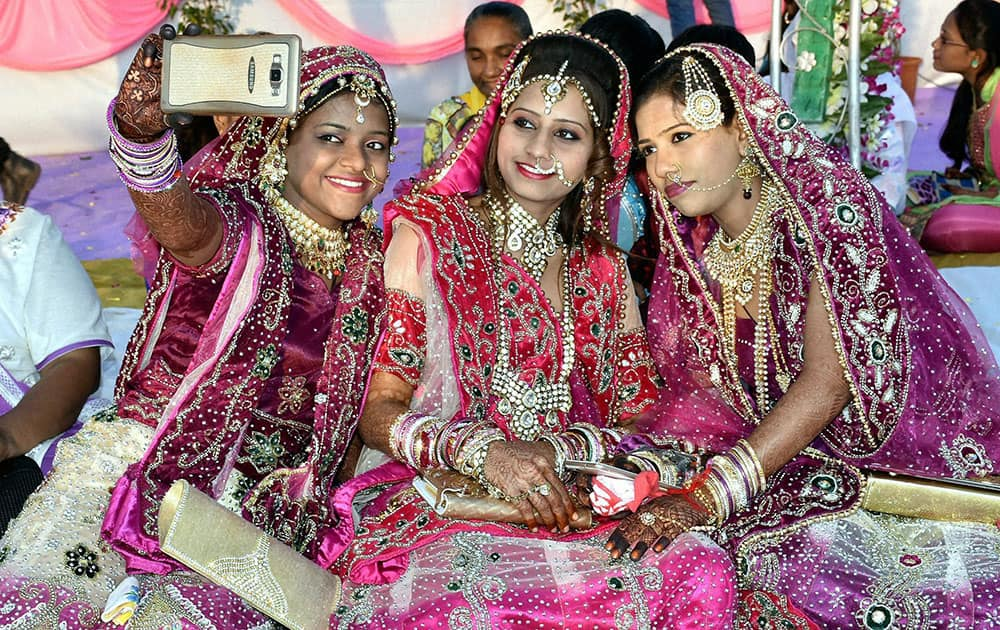 A Brides takes selfie at mass marriage ceremony in Surat.