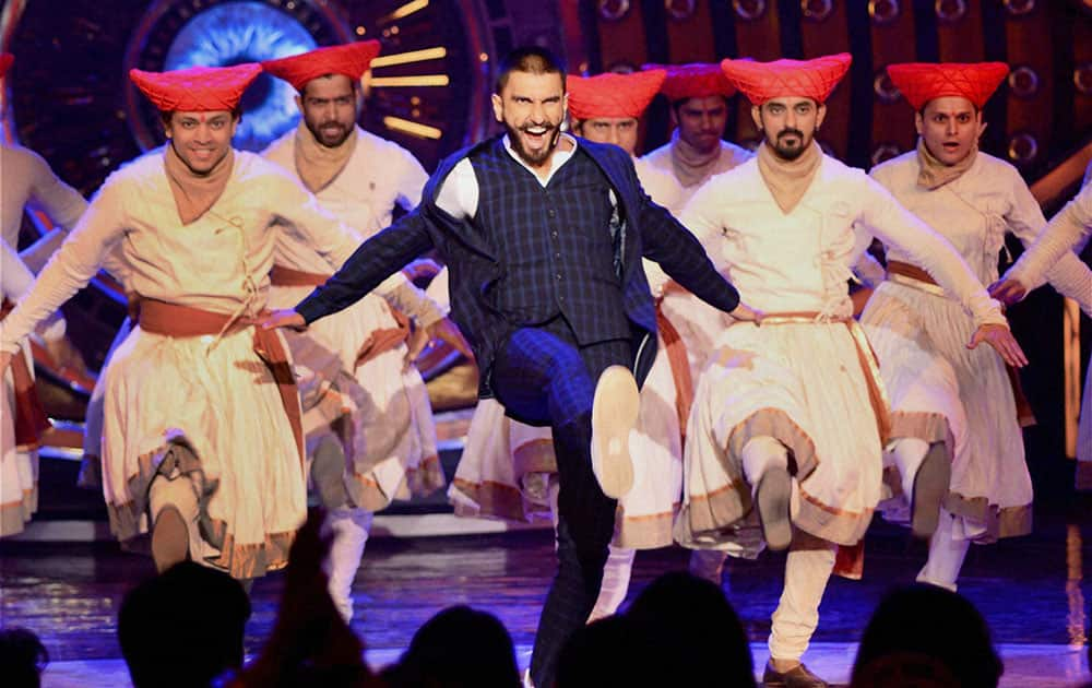 Actor Ranveer Singh performs during the promotion of his upcoming film Bajirao Mastani at a TV show in Mumbai.