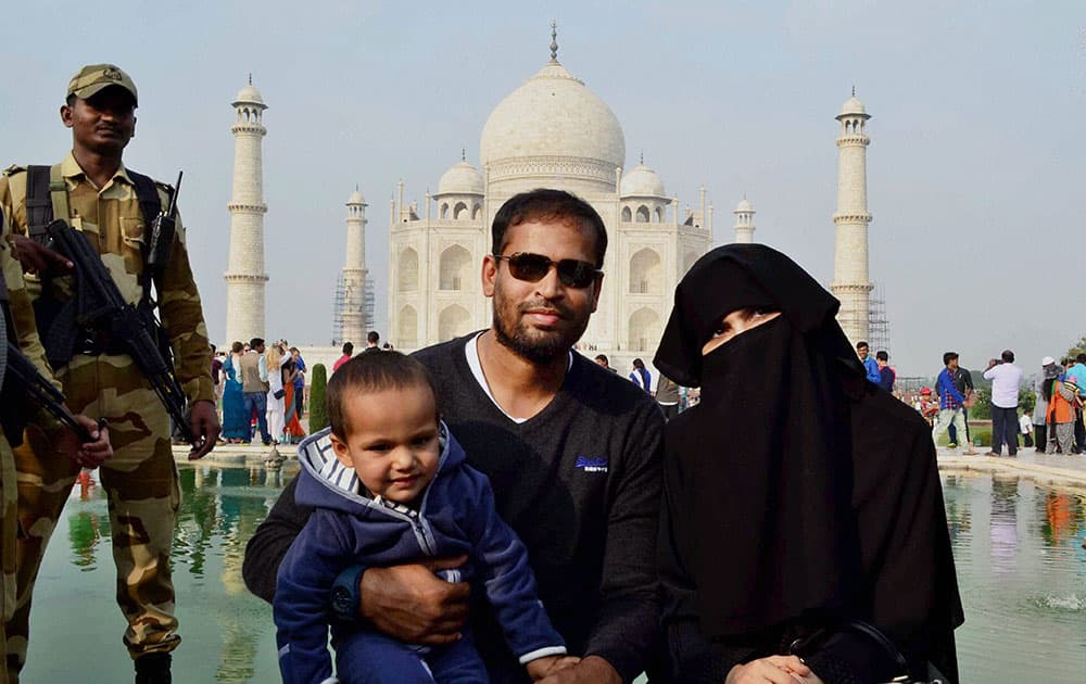 Cricketer Yusuf Pathan with his family poses in front of Taj Mahal in Agra.
