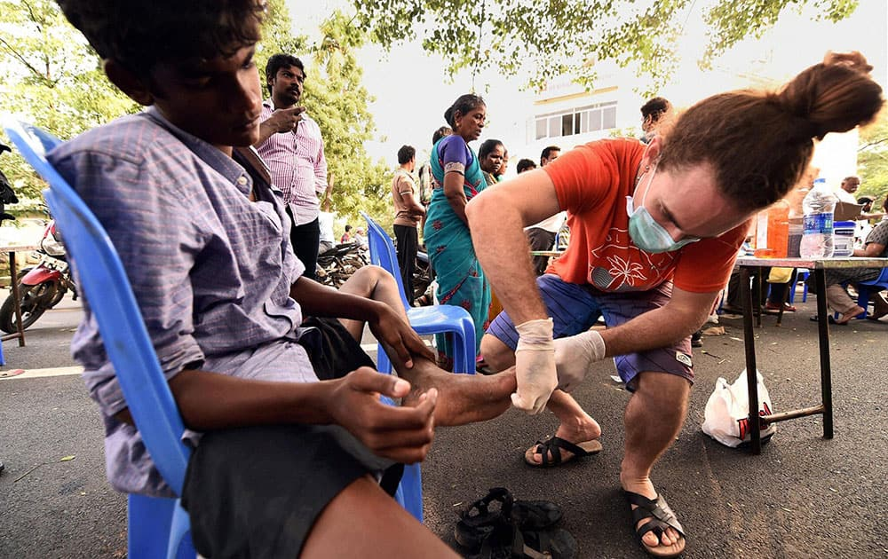 Flood affected people getting medical assistance at a medical camp in Kotturpuram, one of the worst flood-hit localities in Chennai.