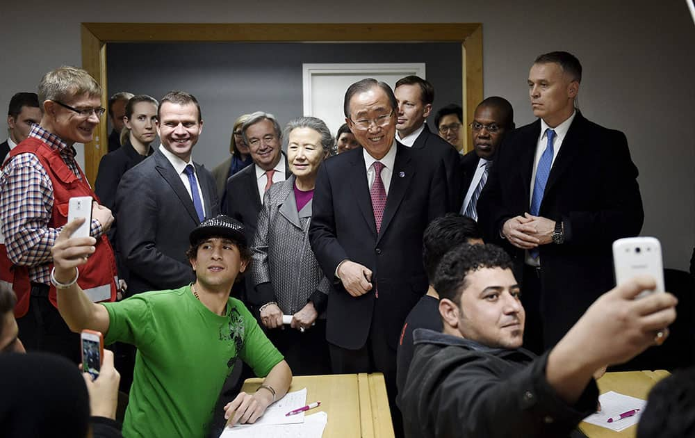 United Nations Secretary General Ban Ki-moon, centre, visits a reception centre for asylum seekers with Finnish Minister of the Interior, Petteri Orpo, second left, in Vantaa, Finland.