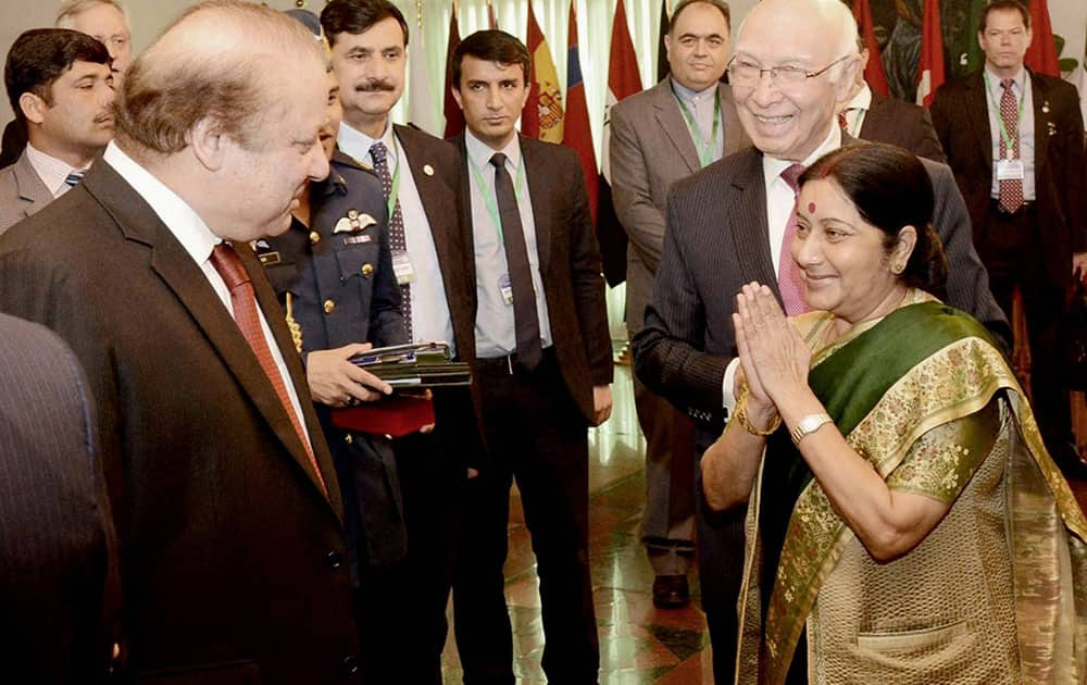 External Affairs Minister Sushma Swaraj greets Pakistan Prime Minister Nawaz Sharif as Pakistans Foreign Affairs Adviser Sartaj Aziz looks on at the Ministerial Conference of Heart of Asia - Istanbul Process in Islamabad.