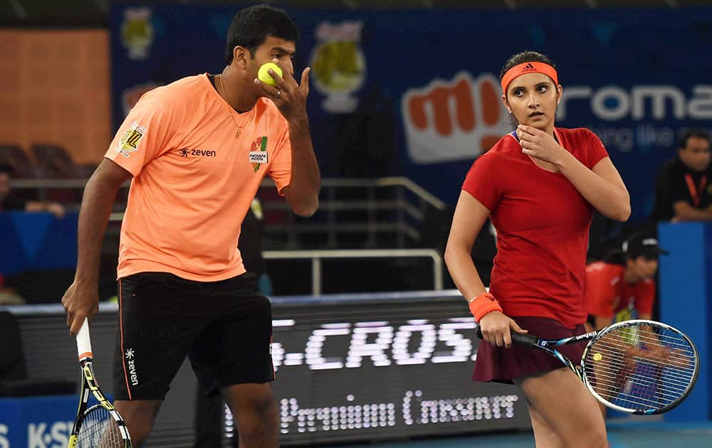 Sania Mirza and Rohan Bopanna of Micromax Indian Aces in action during the International Premier Tennis League (IPTL) match at the IG Stadium in New Delhi.