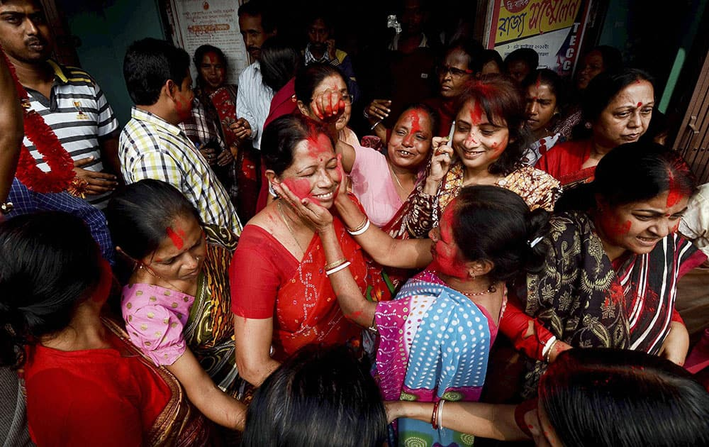 CPI(M) supporters celebrate their victory in civic polls in Dharmanagar, north Tripura.