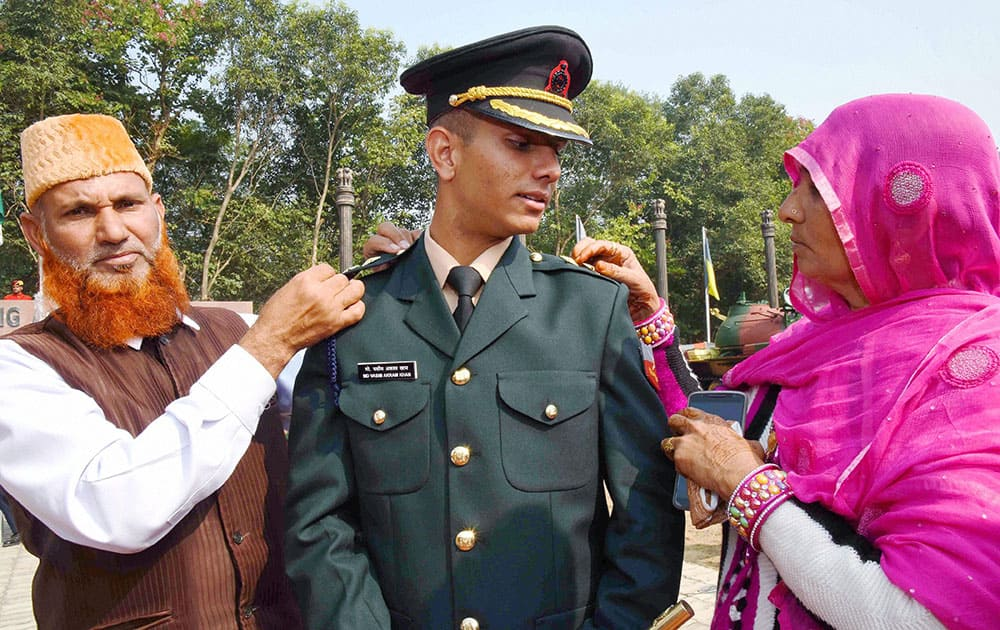 Parents piping their son at the Passing Out Parade at Officers Training Academy in Gaya.