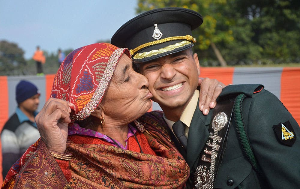 A gentleman cadet is greeted by his grandmother after the graduation ceremony at IMA Dehradun.