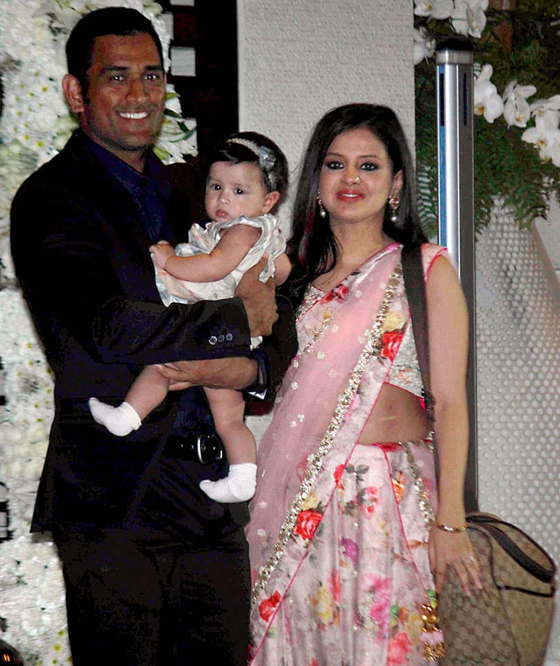 Cricketer Mahendra Singh Dhoni along with his wife Sakshi Dhoni and daughter Ziva during the wedding celebrations for cricketers Harbhajan Singh and Rohit Sharma.