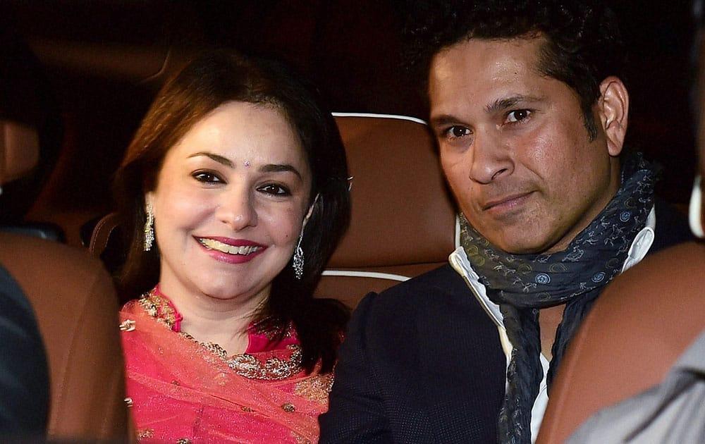 Sachin Tendulkar along with wife Anjali Tendulkar arrives to attend the wedding of cricketer Rohit Sharma.