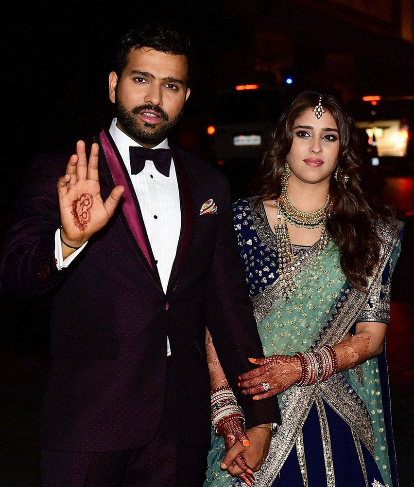 Newly wed couple cricketer Rohit Sharma and Ritika Sajdeh pose for a photo at their wedding venue.