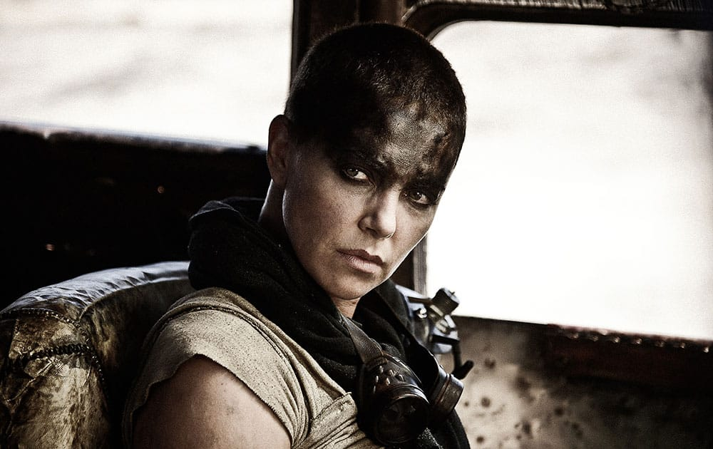 """This photo provided by Warner Bros. Pictures shows Charlize Theron as Imperator Furiosa in Warner Bros. Pictures' and Village Roadshow Pictures' action adventure film, """"Mad Max: Fury Road,"""