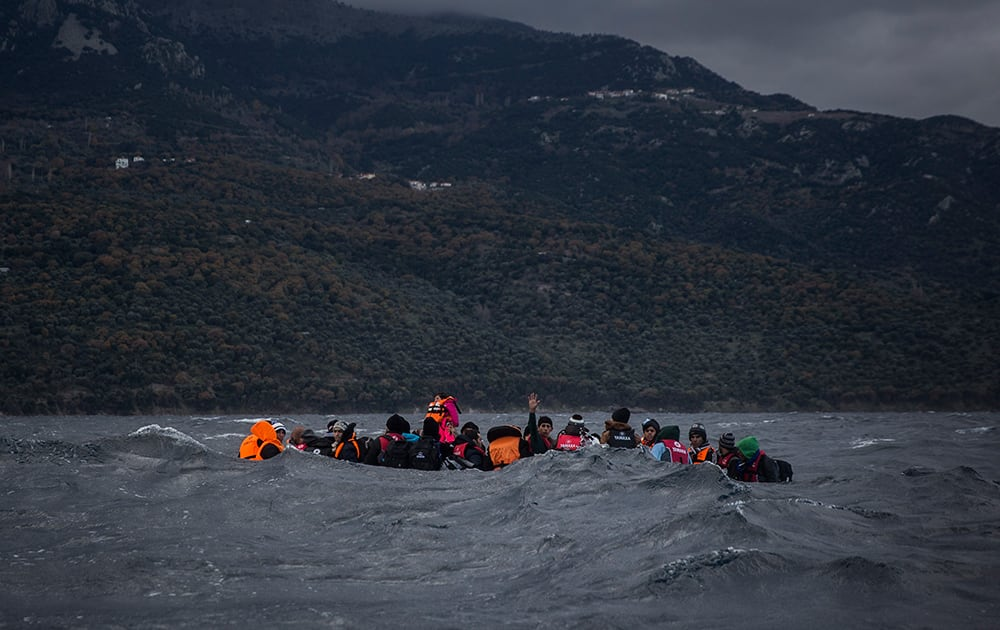 Refugees and migrants on a dinghy approaching the Greek island of Lesbos. According to the International Organization for Migration, more than 920,000 people have entered the EU so far this year.