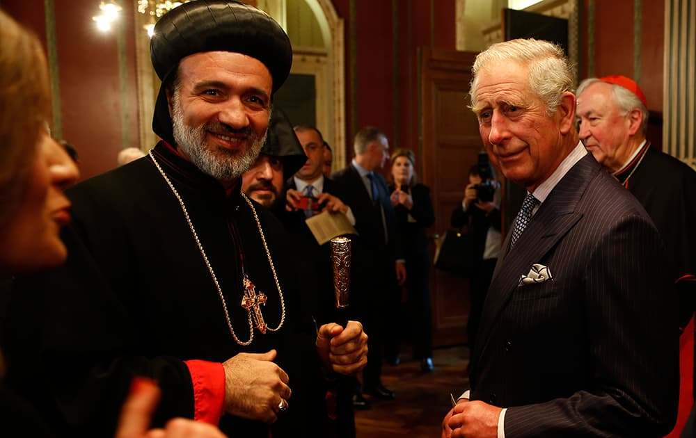 Britain's Prince Charles talks to Archbishop Athanasius Toma Dawod, left, of the Syrian Orthodox Church during a reception for various religious leaders in London.