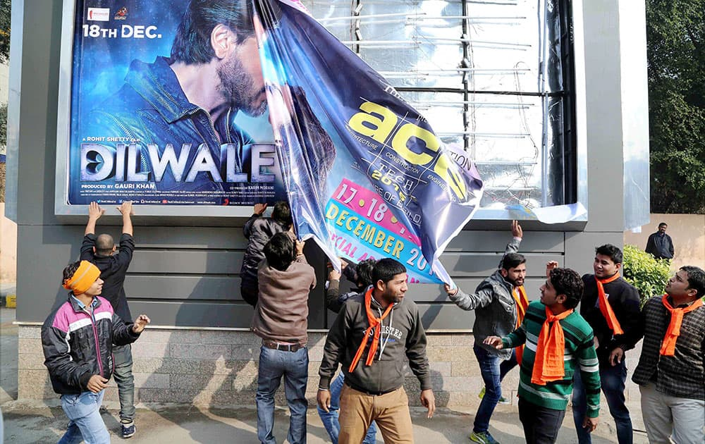 Hindu Sena activists tearing a poster of actor Shaharukh Khans film Dilwale during a protest against its screening.
