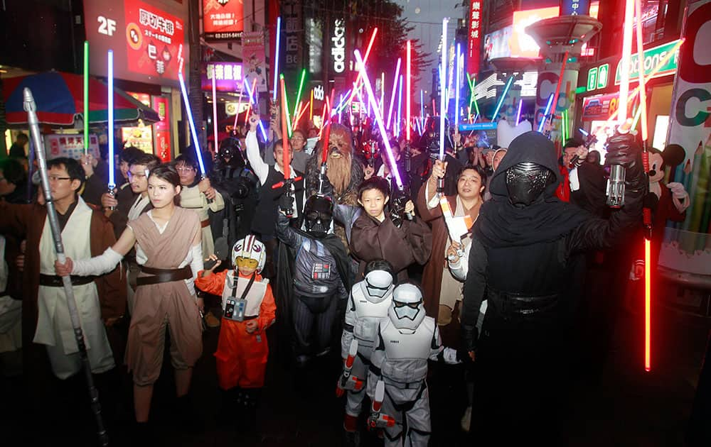 Fans dressed as Star Wars characters parade outside a movie theater showing 'Star Wars: The Force Awakens', in Taipei, Taiwan.
