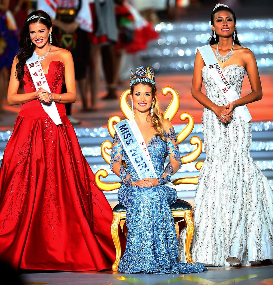 Miss World Mireia Lalaguna Royo from Spain, centre, Sofia Nikitchuk from Russia, left, the runner-up, and Maria Harfanti from Indonesia, right, the second runner-up celebrate at the end of the 2015 Miss World Grand Final in Sanya in south China's Hainan province.