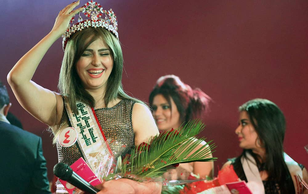 Newly crowned Miss Iraq Shaima Qassim, as she celebrates after being crowned the end of the 2015 Miss Iraq Final, in Baghdad, Iraq.