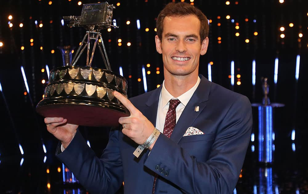 British tennis player Andy Murray poses with the trophy after winning the 2015 Sports Personality of the Year, in Belfast, Northern Ireland.