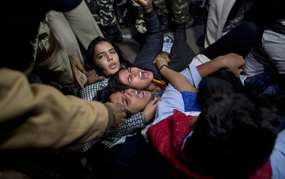youth shout slogans as they are detained by police during a protest against the release of a juvenile convicted in the fatal 2012 gang rape that shook the country in New Delhi, India.