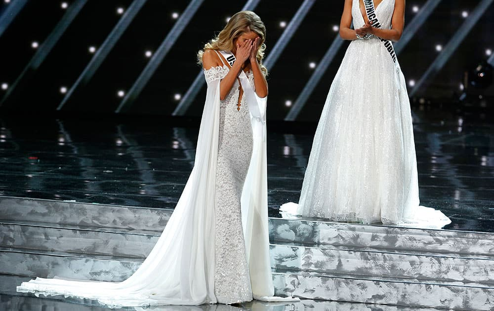 Miss USA Olivia Jordan reacts as she makes it into the final five at the Miss Universe pageant in Las Vegas.