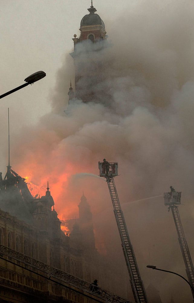 Firefighters work to douse the flames at the Portuguese Language Museum in Sao Paulo, Brazil.