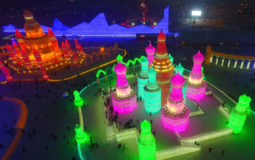 Visitors tour the Ice and Snow World in Harbin in northeastern Chinas Heilongjiang province, the night of the soft opening of the annual tourist attraction.