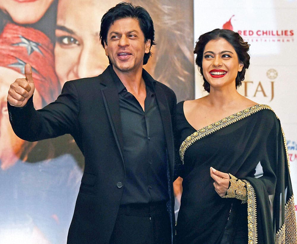 Bollywood actors Shahrukh Khan and Kajol pose during promotion of their new film Dilwale in Kolkata.