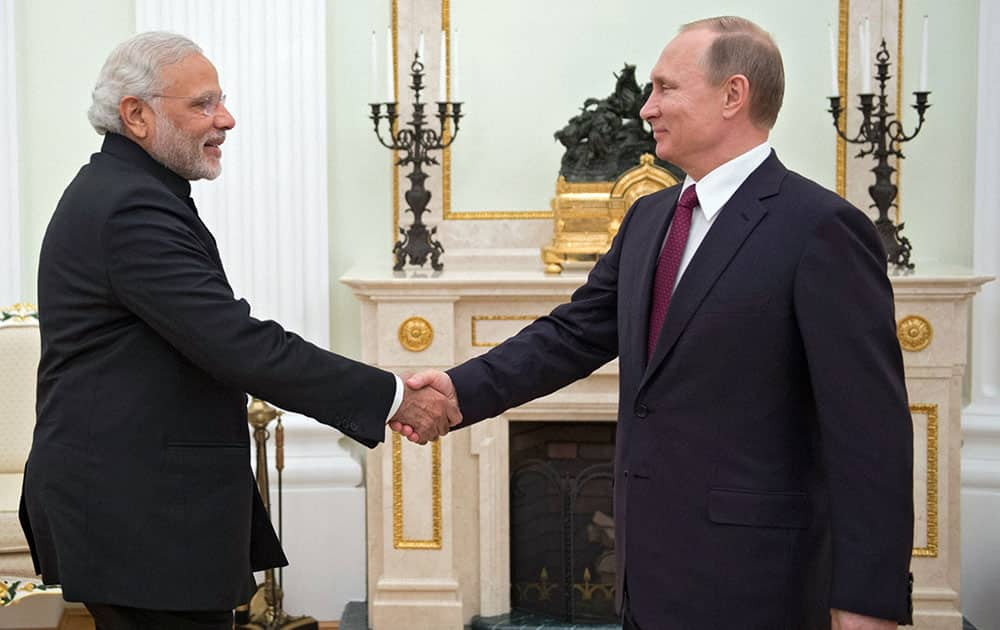 Russian President Vladimir Putin greets Indian Prime Minister Narendra Modi during their meeting in the Kremlin in Moscow, Belarus.