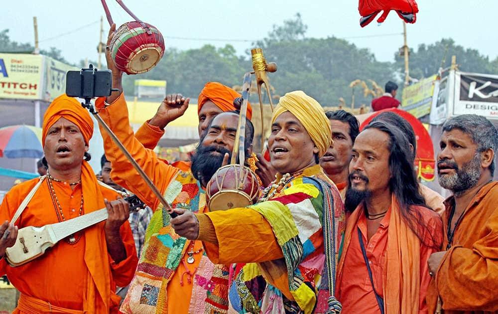 Rural folk singers (bouls) take a selfie on their arrival to participate in the 121st Santiniketan Poush Mela at Santiniketan in Birbhum district of West Bengal.