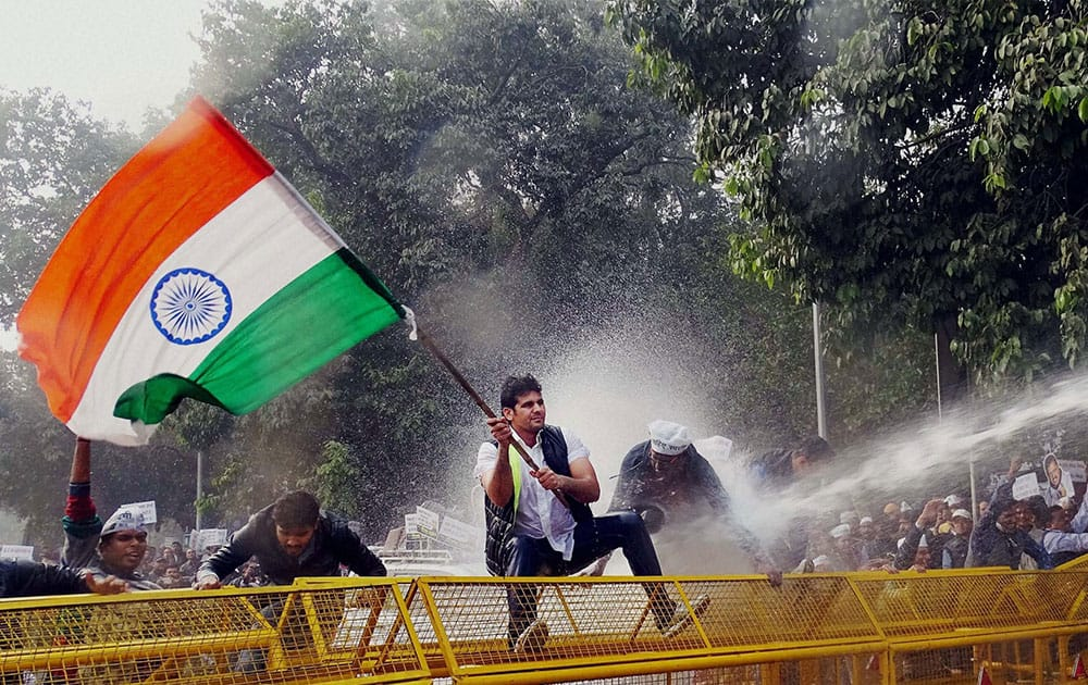 Aam Aadmi Party (AAP) volunteers face water cannons during a protest against Finance Minister Arun Jaitley near his residence in New Delhi.