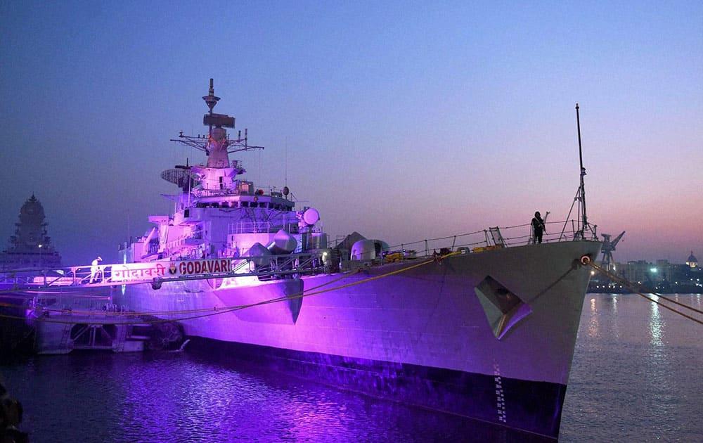 INS Godavari lit up during its decommissioning at the naval dockyard in Mumbai.
