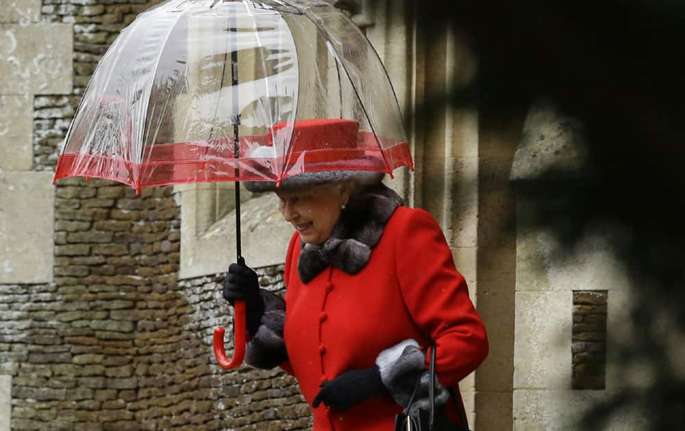 Britain's Queen Elizabeth II shelters under an umbrella as she leaves, after attending the British royal family's traditional Christmas Day church service at St. Mary Magdalene Church in Sandringham, England.