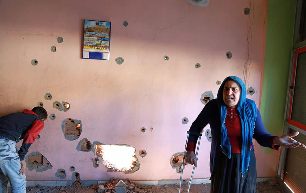 A woman complains inside her house in Nusaybin, Turkey.