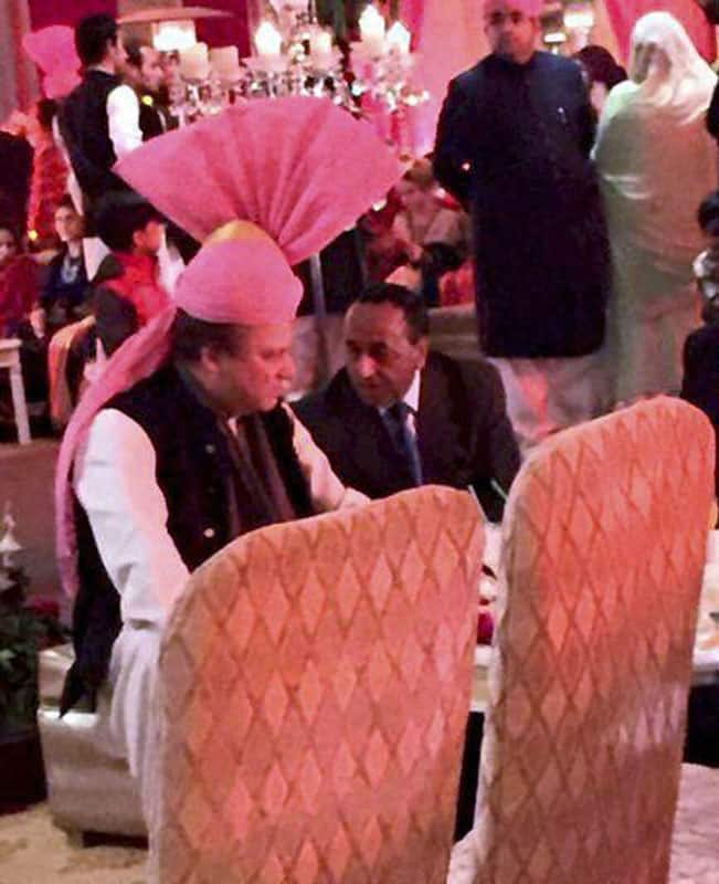 Pakistan Prime Minister Nawaz Sharif wearing pink turban gifted by Prime Minister Narendra Modi, during the wedding of his granddaughter at his residence in Raiwind.