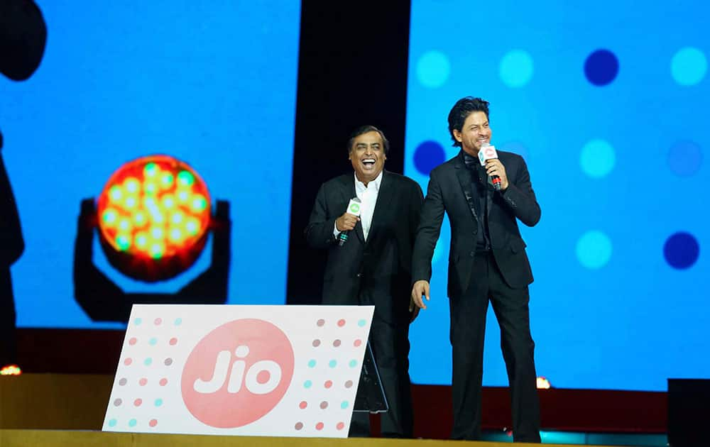 Reliance Industries Limited Chairman and Managing Director Mukesh Ambani with actor Shahrukh Khan at the launch of Reliance Jios 4G services for its employees in Mumbai.