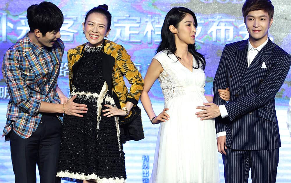 Chinese actress and co-producer Zhang Ziyi, second from left, shares a light moment with cast members Chen Xuedong, left, Jiang Wen, second from right, and Zhang Yixing on stage during a press conference of their new movie