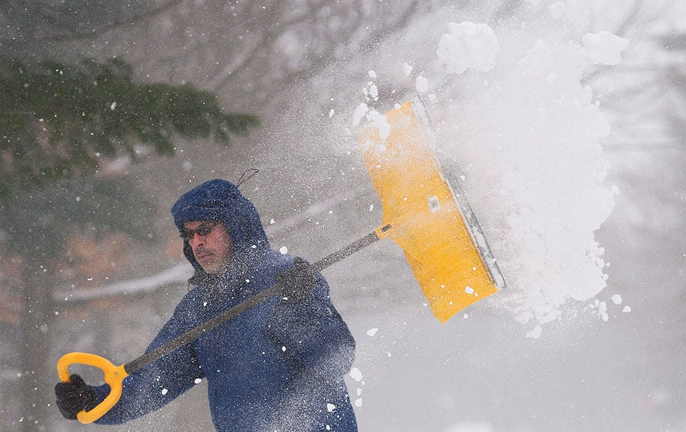 Mike Stefanakis shovels his driveway in Saint Lazare, west of Montreal.