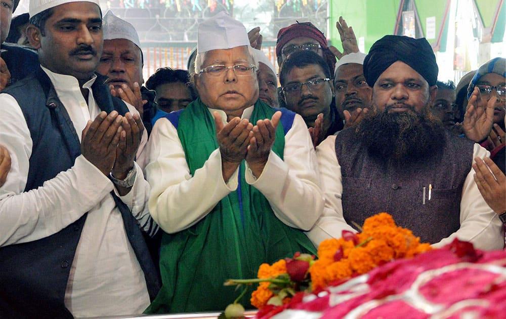 RJD chief Lalu Prasad prays at High Court Mazar during the Urs celebrations in Patna.
