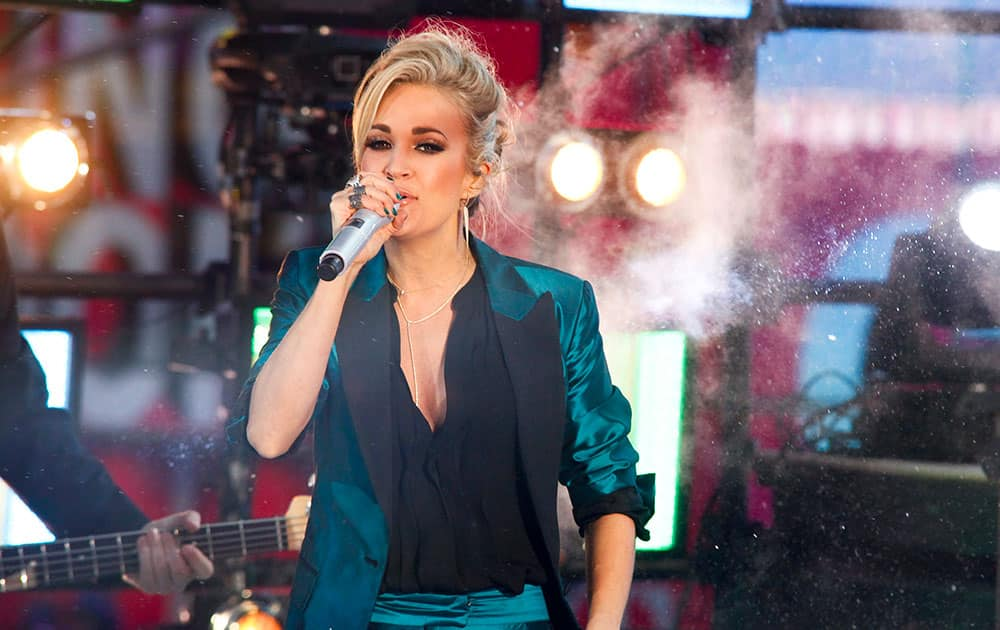 Carrie Underwood performs at the Times Square New Year's Eve celebration, in New York.