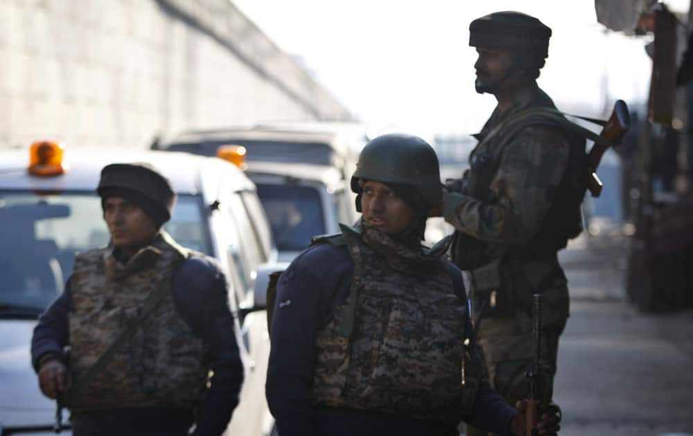 Indian security forces stand outside an Indian air force base in Pathankot.