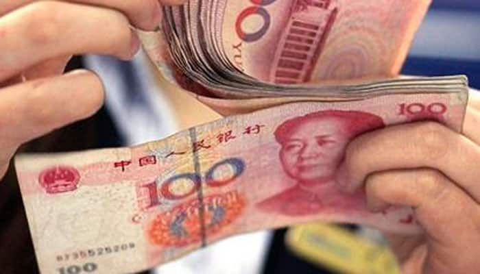 China cuts yuan to weaker than 6.5 against dollar