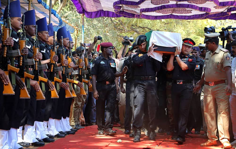 The body of India's National Security Guard commando, Niranjan Kumar, is carried by Indian soldiers as they pay their last respects in Bangalore.