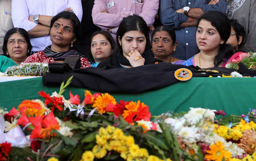 Radhika looks at the coffin of her husband and India's National Security Guard commando, Niranjan Kumar, who was among those killed in the attack on the Pathankot air force base after the body was brought to Bangalore.