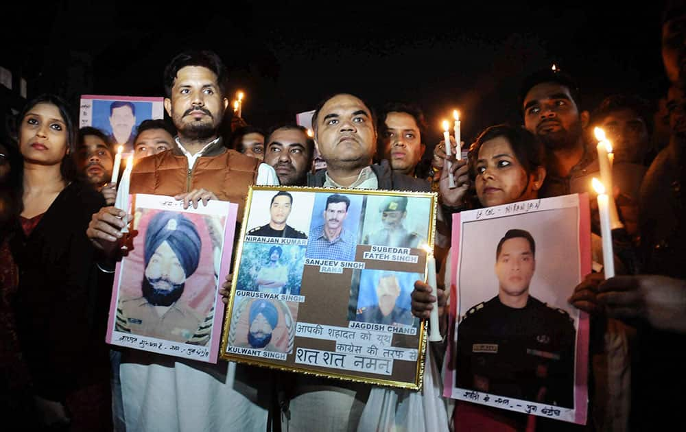 Youth Congress National President Amarinder Singh Raja along with supporters take part in a candle light march to pay tribute to the martyrs of Pathankot attack, at Jantar Mantar in New Delhi.